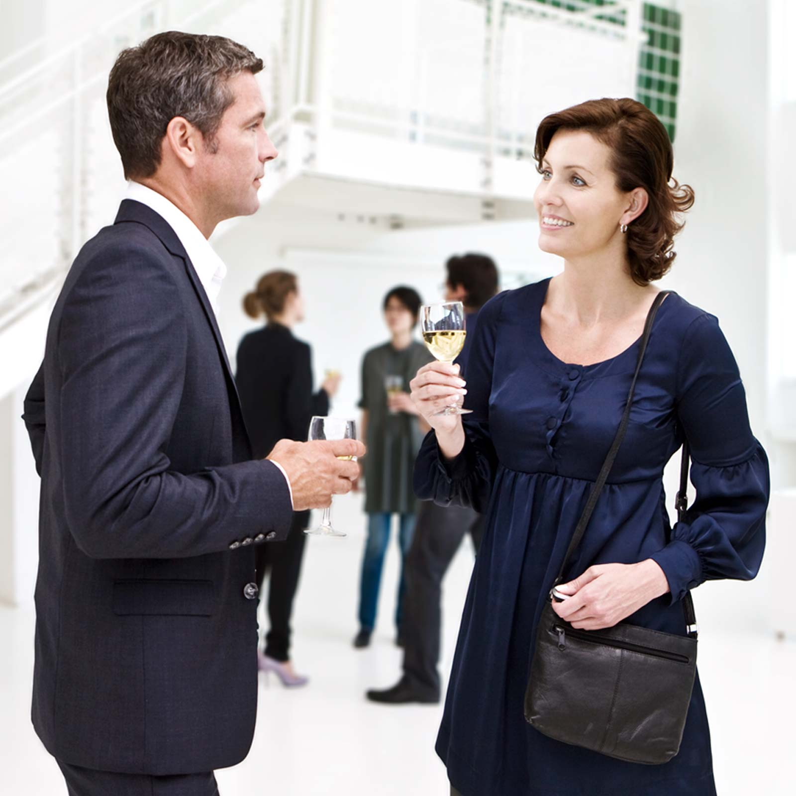 rc-dex-woman-talking-to-man-reception